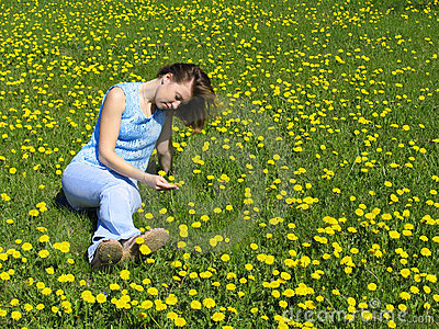 Girl on dandelion lawn