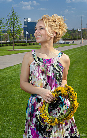 Girl with dandelion wreath