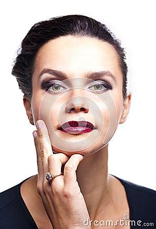 Girl in dark makeup wearing a ring
