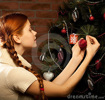 Girl decorate the Christmas tree