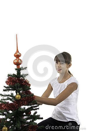 Girl decorate a New Year tree