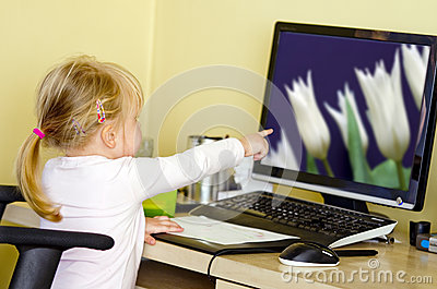 Girl at desktop computer