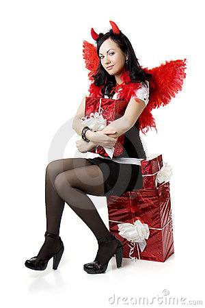 Girl in a devil costume with a gift