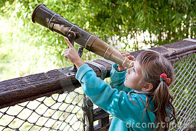 Girl discovers through old-style telescope