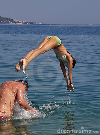 Girl diveing in sea