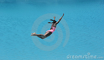 Girl Diving Into Beautiful Blue Water