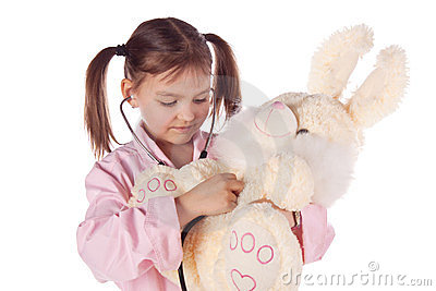 Girl, a doctor, the child, rabbit toy