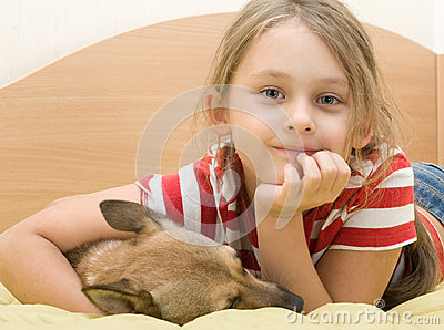 Girl with a dog on the bed