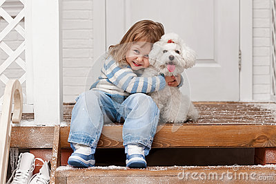 Girl with a dog on the front porch