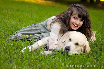 Girl with dog on the grass