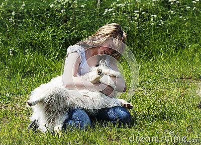 Girl and dog - loving relationship