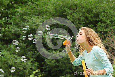 Girl doing bubble soap