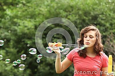 Girl doing bubble soap