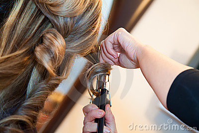 Girl doing hairstyle curling