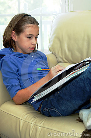 Free Girl Doing Homework Stock Photography - 6390562