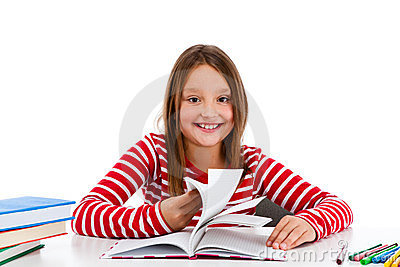 Girl doing homework isolated on white background