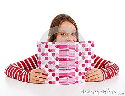 Girl doing homework isolated on white background