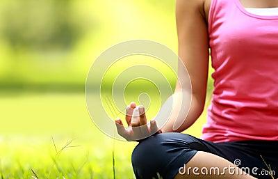 Girl doing meditation on the beach
