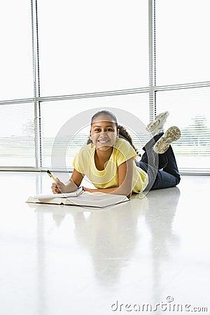 Girl doing schoolwork.