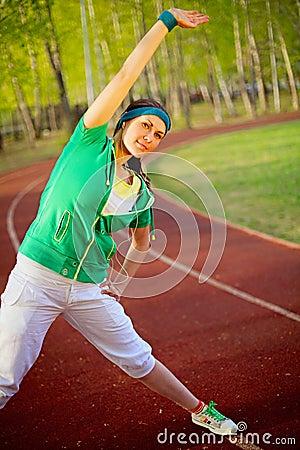 Girl doing sport exercises summer morning