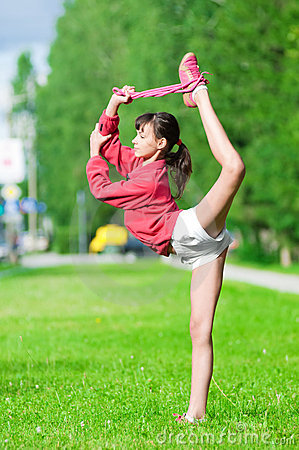girl doing stretching exercise yoga stock photo  image