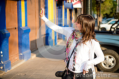 Girl doing an urban self portrait