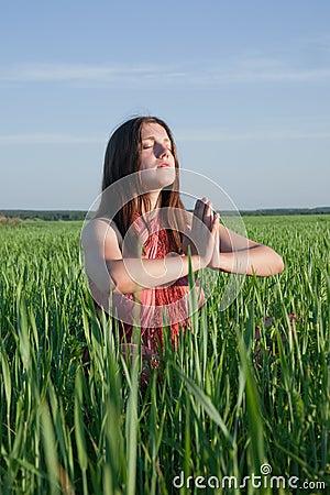 Girl doing yoga against nature