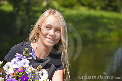 Girl, dragonfly and flowers