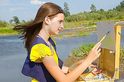 Girl drawing in the open air