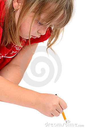 Girl drawing something with a pencil isolated