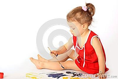 A girl draws.
