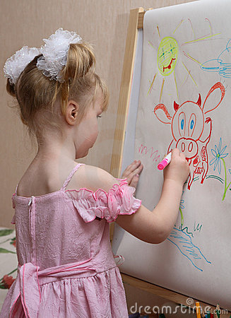 Girl Draws A Cow Royalty Free Stock Photo - Image: 7313285