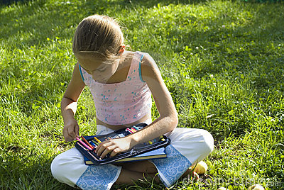 The girl draws on a meadow IV