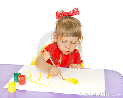 The girl draws paints