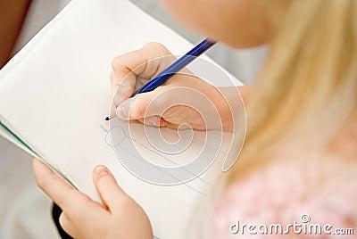Girl draws pencil
