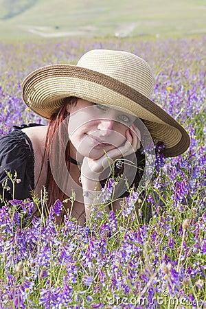 Girl dreaming in violet flowers