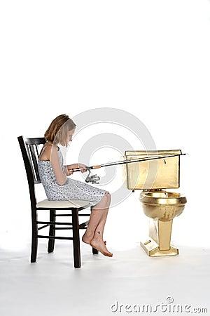 Girl in dress fishing in a golden toilet