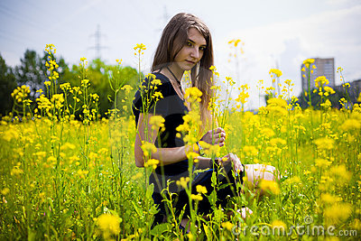 Girl dress in the grass with dandelions