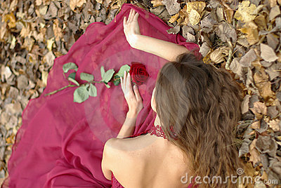Girl in dress with rose lying