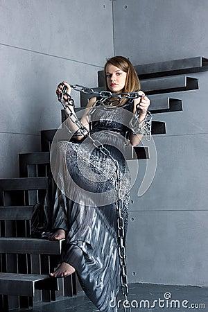 Girl in dress sitting