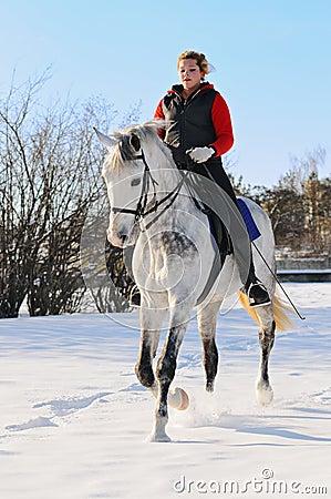 Girl on dressage horse in winter