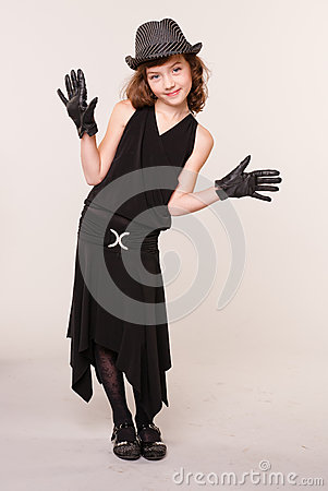 A girl dressed as a gangster