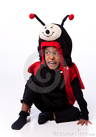 Girl dressed as lady bug