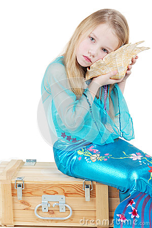 Girl dressed as mermaid sits and listen to noise