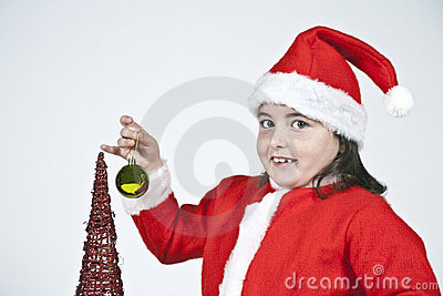 Girl dressed as Santa Claus with Christmas