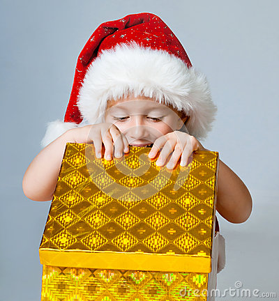 Girl dressed as Santa with gifts