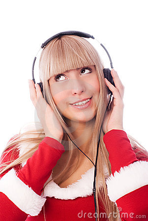 Girl dressed as Santa listening to the music
