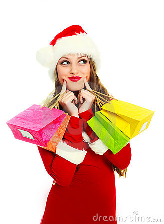 Girl dressed as Santa with presents
