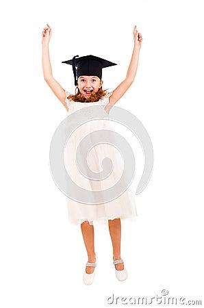 Girl dressed Bachelor cap jumping
