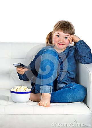 Girl dressed in blue denim watching TV